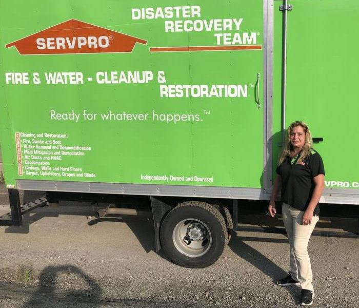 person in front of SERVPRO truck