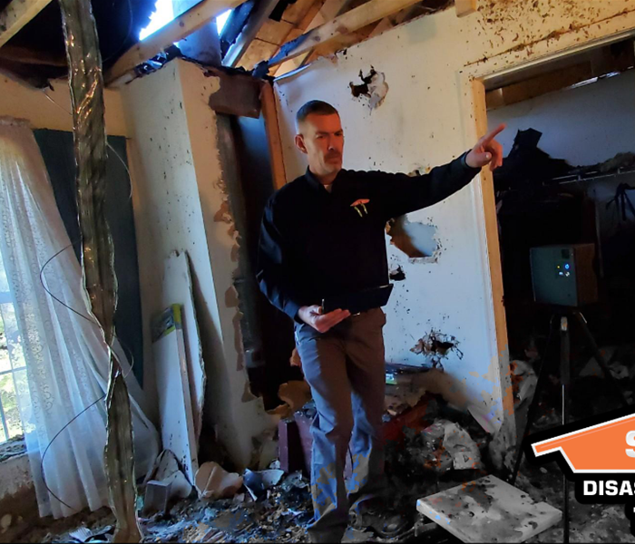 Man in burnt down house using Matterport